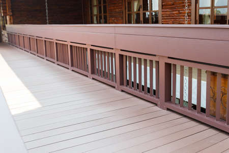 bannister: the bannister of wooden walkway on the terrace