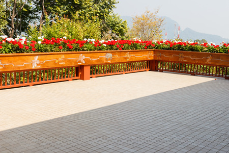 bannister: flowerbed decorating on the wooden bannister of the terrace