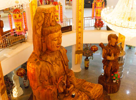 goddess of mercy: wooden goddess of mercy (Guan Yin) statue in asian temple Stock Photo