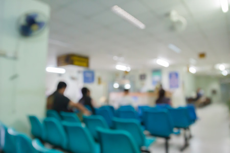 blurry defocused image of patient sitting on chair waiting for doctor in public hospital for background Reklamní fotografie - 39120891