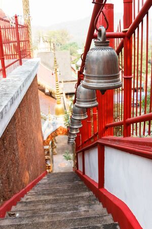 alloy: row of alloy bell on the stairway in asian temple