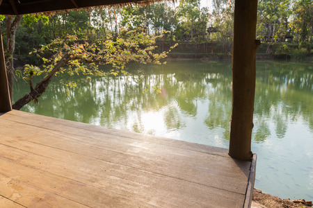view from the wooden gazebo beside the lake which can see the sunlight, ripple and reflection photo