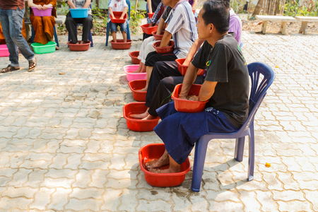 soaking: CHIANGMAI, THAILAND - APRIL 5: People are soaking their hands and feet with herbal water for skin detoxifying in Umong temple on April 5, 2015 in Chiangmai, Thailand.