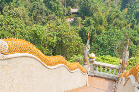 naga statue decorating on bannister of stairway in asian temple photo