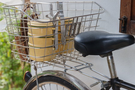 tiffin: the thailand traditional beige tiffin carrier in bicycle basket