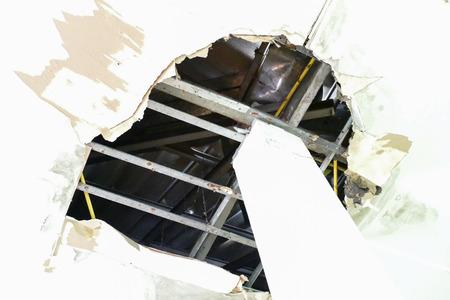 home destruction: damaged or broken ceiling in the old building