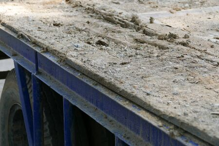 dumper: dirt on the old blue truck dumper for construction