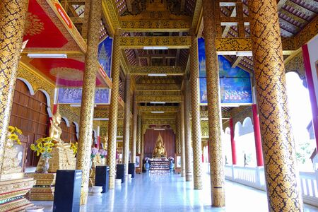spiritual architecture: row of golden buddha statue in monastery in  thailand Editorial