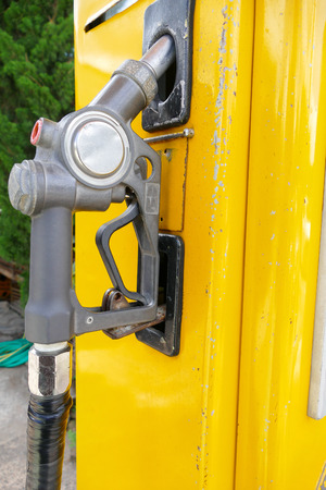 nozzle: old fuel nozzle dispenser for adding gasoline Stock Photo