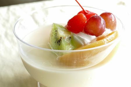 vanilla pudding: vanilla pudding mousse topping with strawberry, mango, cherry, kiwi and grape