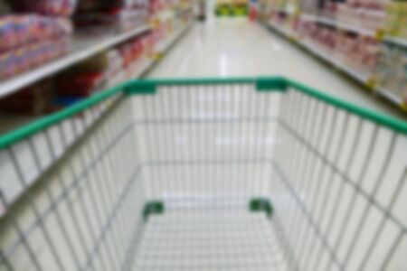 aisle: cart in aisle of supermarket grocery store Stock Photo