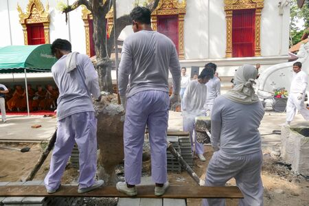 metal casting: Chiang Mai, Thailand -  July 8, 2015: The man is pouring melting metal in furnace for casting buddha statue in Suntidham temple on July 8, 20.15 in Chiang Mai, Thailand.