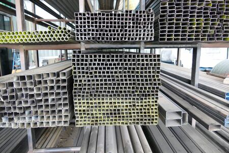 ironworks: stack of metal tube in the factory warehouse Stock Photo