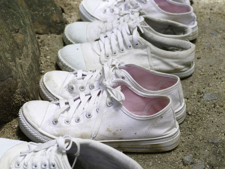 pairs: many pairs of old white sneaker on the ground