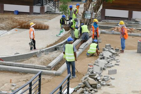constructing: Chiang Mai, Thailand - July 25, 2015: The workers are constructing pathway at the construction site in Nirotharam temple.