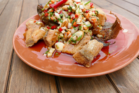 sweet food: fried fish with carrot, shallot, peanut, chili and sweet and sour sauce Stock Photo