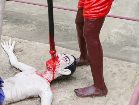 tortured: white man is tortured and killed by black man statue in asian temple