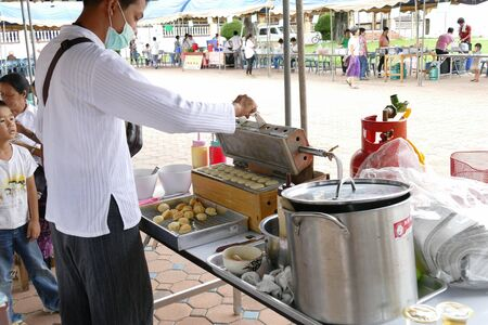 thai dessert: Chiang Mai, Thailand -  July 26, 2015: The man is making thailand traditional egg cake for give for free for any people who participating in Dhamma talk fair arranged at Suandok temple.