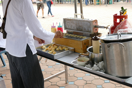 dhamma: The man is making thailand traditional egg cake for give for free for any people who participating in Dhamma talk fair arranged at Suandok temple.