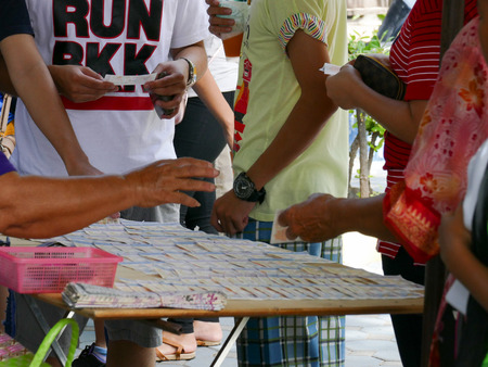 thai people: thai people are buying lottery ticket in Muang temple.