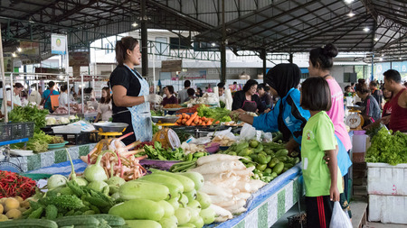 nakhon: Nakhon Si Thammarat, Thailand - July 31, 2015: People buy and sell food in the local market in Sichon district.