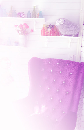 Purple Velvet Armchair Near White Wall Decorating With Colorful Glass  Bottle, Flower In The Vase