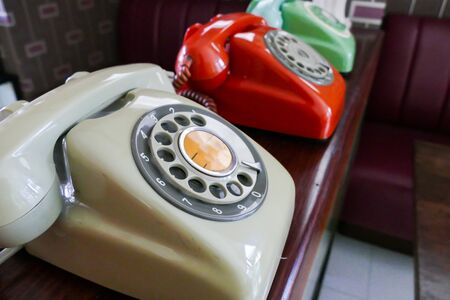 rosso verde: old beige, red, green dialling telephone for vintage style decoration Archivio Fotografico