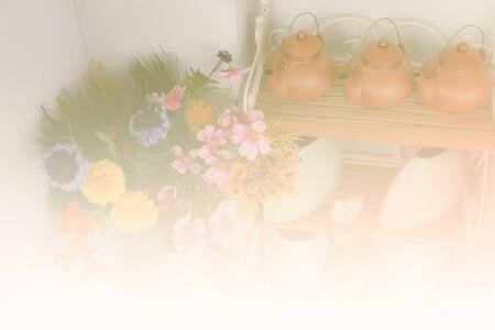 vase color: kettle, ceramic mug jar on shelf and bouquet of colorful fake flower in vase (color filter and soft focus)