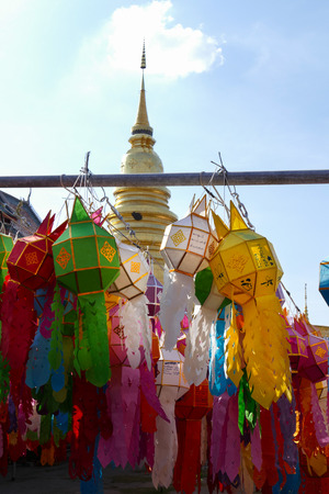 colorful paper lantern decoration for Yeepeng festival and golden pagoda monument at temple in Thailand