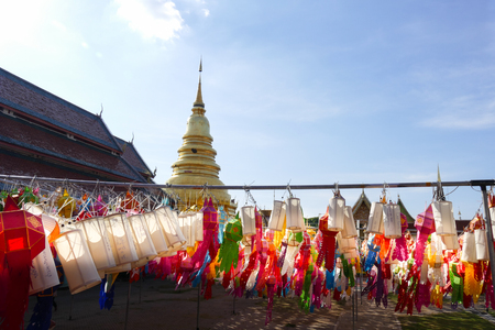thailand culture: colorful paper lantern decoration for Yeepeng festival and golden pagoda monument at temple in Thailand