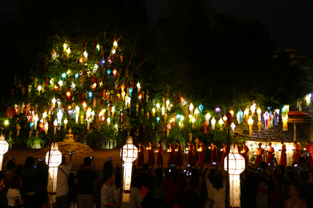 yeepeng: Chiang Mai, Thailand - November 26, 2015: Tourist travel to see colorful paper lantern and monk ceremony in Yeepeng festival at Puntao temple in Chiang Mai, Thailand on November 26, 2015.