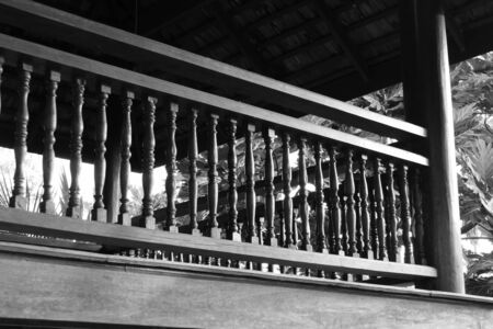bannister: old wooden bannister of the balcony terrace, black and white