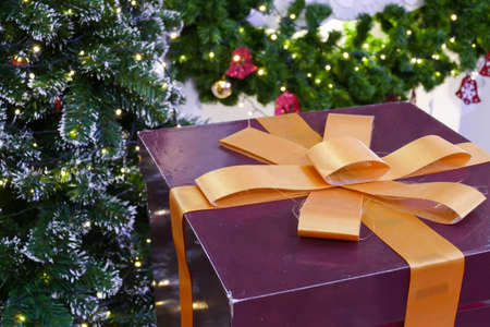 christmas gift box: gift box present with ribbon and christmas tree for christmas and new year concept