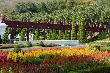 asian gardening: view of the asian style bridge and flowerbed in the garden