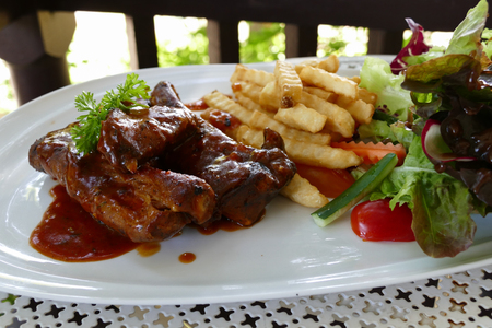 barbecue: pork spare ribs barbecue serving with french fried and lettuce salad