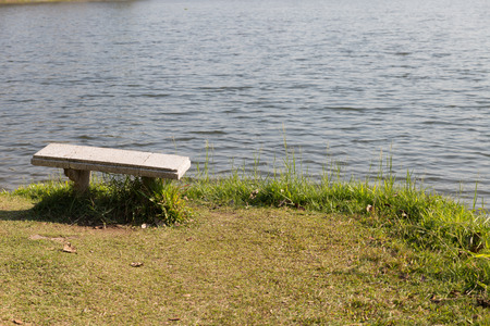waterside: old bench at the waterside of the pond