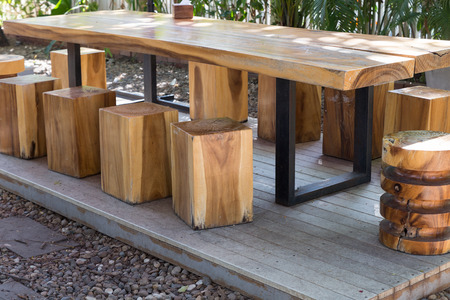 stool: wooden table and stool on pallet in the garden