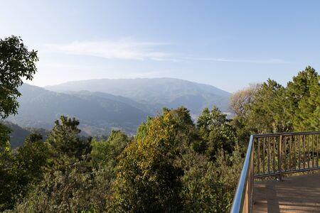 banister: metal banister of balcony with mountain view Stock Photo