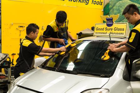 coachwork: Chiang Mai, Thailand - February 16, 2016: Repairman is repairing windshield of the car at good sure glass company in Chiang Mai, Thailand on February 16, 2016.