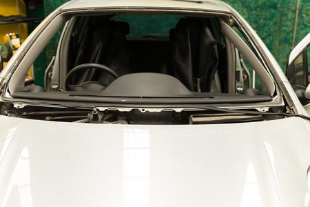 coachwork: car in garage during windshield changing process