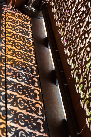 bannister: the shadow of sculpture of wooden bannister in Thailand