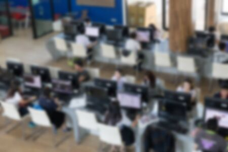 use computer: student use computer to access to internet for education in university (blurry defocused image) Stock Photo