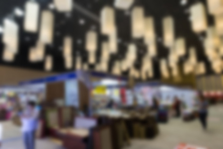 tradeshow: blur background of people shopping in fair tradeshow which retailer selling various product