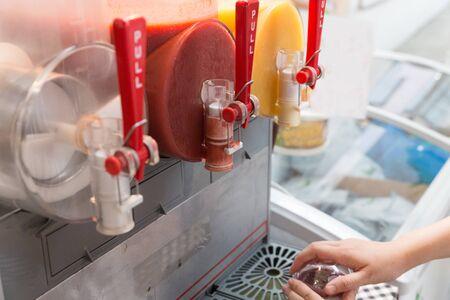 slush: fruit juice in slush machine for selling in market