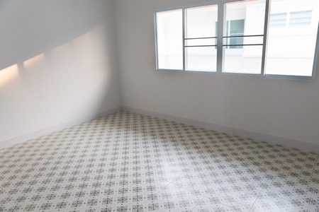 sliding: empty room with sliding window and beige tile floor