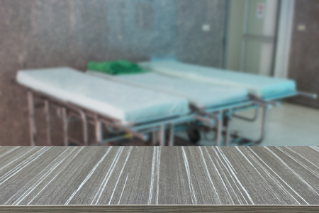 gurney: stretcher gurney for patient in hospital (blur background and wooden table for displaying your product)