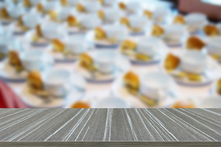creamer: many empty cup on saucer with spoon, non-dairy creamer and sugar for coffee break (blur background and wooden table for displaying your product)
