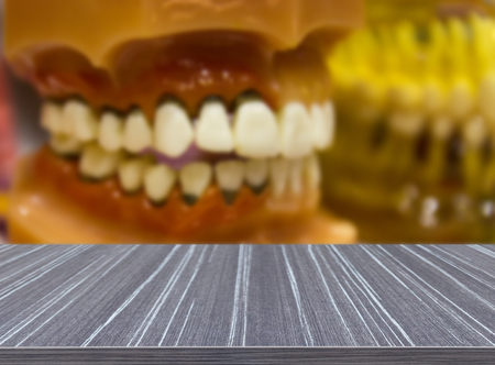 prosthesis: the teeth prosthesis model for oral education (blur background and wooden table for displaying your product)