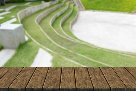 tiered: tiered seat of the amphitheater and outdoor stage (blur background with wood table top for display or montage your product)