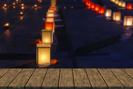 paper lantern and candle light in Yeepeng festival in Chiang Mai, Thailand (blur background with wood table top for display or montage your product)